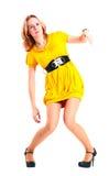 Mujer en alineada amarilla. Fotos de archivo