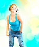 Mujer en auriculares Imagen de archivo libre de regalías
