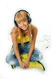 Mujer en auriculares Fotos de archivo libres de regalías