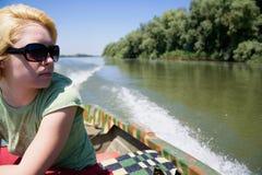Mujer en barco Imagen de archivo libre de regalías