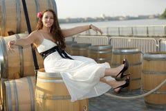 Mujer en barril de vino Imágenes de archivo libres de regalías
