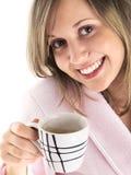 Mujer en bata de casa con café Imagenes de archivo