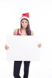 Mujer en blanco de la muestra de la Navidad Foto de archivo libre de regalías