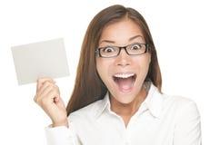 Mujer en blanco de la muestra emocionada Imagen de archivo
