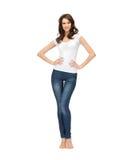 Mujer en camiseta blanca en blanco Imagen de archivo libre de regalías