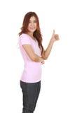 Mujer en camiseta en blanco con los pulgares para arriba Imágenes de archivo libres de regalías
