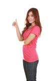 Mujer en camiseta en blanco con los pulgares para arriba Foto de archivo