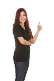 Mujer en camiseta en blanco con los pulgares para arriba Imagen de archivo libre de regalías