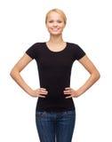 Mujer en camiseta negra en blanco Fotos de archivo libres de regalías