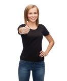 Mujer en camiseta negra en blanco Foto de archivo libre de regalías