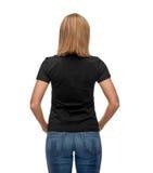 Mujer en camiseta negra en blanco Imagen de archivo