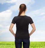 Mujer en camiseta negra en blanco Imagen de archivo libre de regalías
