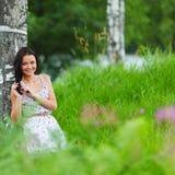 Mujer en campo de flor Imágenes de archivo libres de regalías