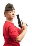 Mujer en casquillo de guarnición con el arma Imagenes de archivo