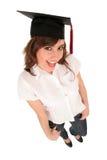 Mujer en casquillo de la graduación Imágenes de archivo libres de regalías