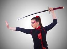 Mujer en concepto japonés del arte marcial Imagen de archivo libre de regalías