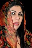Mujer en cordón rojo Fotografía de archivo libre de regalías