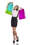 Mujer en desgaste formal con los paquetes coloridos Foto de archivo