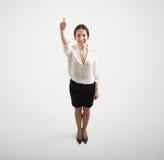 Mujer en desgaste formal con los pulgares para arriba Imágenes de archivo libres de regalías