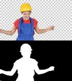Mujer en el baile del casco de la construcci?n, Alpha Channel foto de archivo