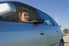 Mujer en el coche Imagen de archivo libre de regalías