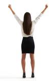 Mujer en el desgaste formal que aumenta sus manos para arriba Foto de archivo libre de regalías