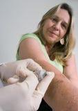 Mujer en el doctor Fotografía de archivo libre de regalías