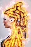 Mujer en el fuego imagen de archivo libre de regalías