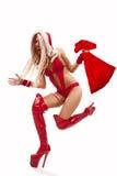 Mujer en el juego de Papá Noel con el bolso del regalo Imágenes de archivo libres de regalías
