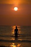 Mujer en el océano Fotografía de archivo libre de regalías