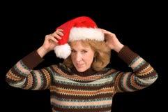 Mujer en el sombrero de Santa Foto de archivo