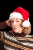 Mujer en el sombrero de Santa Imagenes de archivo