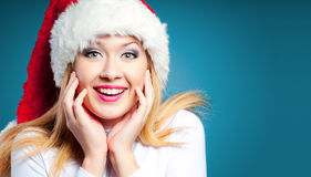 Mujer en el sombrero de Santa Imágenes de archivo libres de regalías