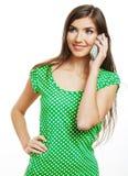 Mujer en el teléfono blanco del uso del fondo Fotografía de archivo