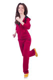Mujer en el traje rojo que hace ejercicios Foto de archivo