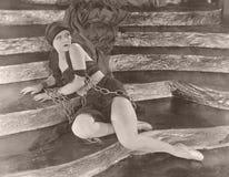 Mujer en encadenamientos fotos de archivo libres de regalías