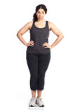 Mujer en escala del peso Imagen de archivo libre de regalías