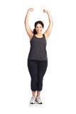 Mujer en escala del peso Foto de archivo