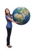 Mujer en globo integral de la tierra que se sostiene Fotos de archivo