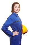 Mujer en guardapolvo azul Fotos de archivo