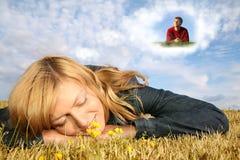 Mujer en hierba y muchacho en nube Foto de archivo libre de regalías