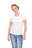 Mujer en la camiseta blanca que presenta en estudio Fotografía de archivo