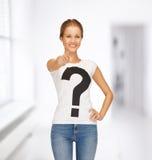 Mujer en la camiseta blanca que señala en usted Foto de archivo