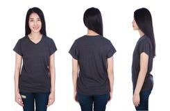 Mujer en la camiseta negra aislada en un blanco Foto de archivo