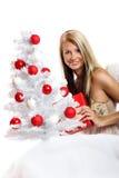 Mujer en la Navidad con un regalo Fotografía de archivo