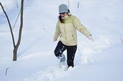 Mujer en la nieve profunda Imagen de archivo libre de regalías