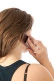 Mujer en la opinión trasera del teléfono Foto de archivo libre de regalías