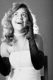 Mujer en la risa del teléfono Fotos de archivo libres de regalías
