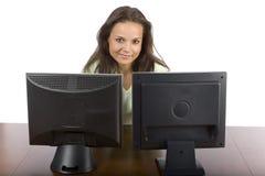 Mujer en las dos pantallas del lcd Fotos de archivo libres de regalías