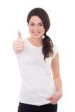 Mujer en los pulgares blancos en blanco de la camiseta para arriba aislados en blanco Foto de archivo